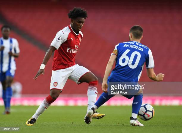 Aaron Eyoma of Arsenal knocks the ball past Rui Moreira of Porto during the match between Arsenal and FC Porto at Emirates Stadium on May 8 2018 in...