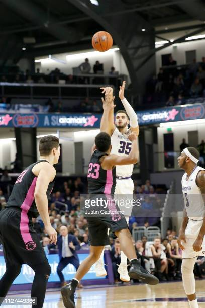 Aaron Falzon of the Northwestern Wildcats shoots the ball while being guarded by Josh Reaves of the Penn State Nittany Lions during the second half...