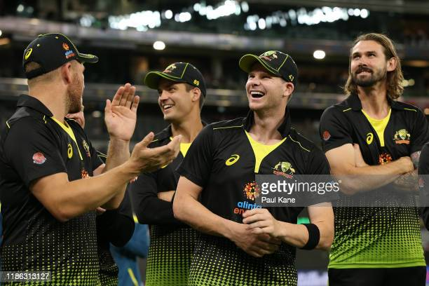 Aaron Finch, Alex Carey, Steven Smith and Kane Richardson of Australia look on before presentations during game three of the International Twenty20...