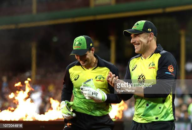 Aaron Finch and Alex Carey of Australia walk out to field during the International Twenty20 match between Australia and India at Sydney Cricket...
