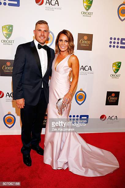Aaron Finch and Amy Griffithsarrive at the 2016 Allan Border Medal ceremony at Crown Palladium on January 27 2016 in Melbourne Australia