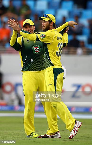 Aaron Finch and Glenn Maxwell of Australia celebrates the dismissal of Misbah Ul Haq during the second match of the one day international series...