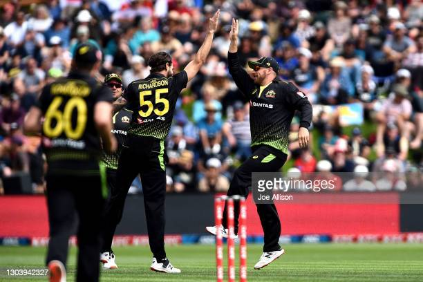 Aaron Finch and Kane Richardson of Australia celebrate the wicket of Tim Seifert during game two of the International T20 series between New Zealand...