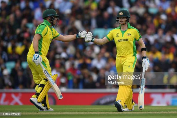 Aaron Finch and Steven Smith of Australia fist pump during the Group Stage match of the ICC Cricket World Cup 2019 between Sri Lanka and Australia at...