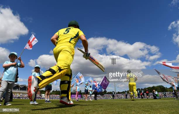 Aaron Finch and Travis Head of Australia run on to the field ahead of the 4th Royal London One Day International between England and Australia at...