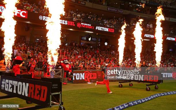 Aaron Finch captain of the Renegades leads his side onto the field during the Big Bash League match between the Melbourne Renegades and the Brisbane...