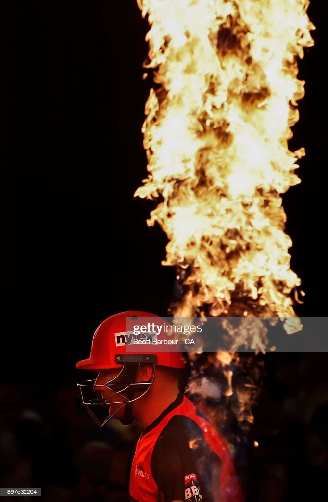 Aaron Finch, captain of the Renegades walks out to bat through flames during the Big Bash League match between the Melbourne Renegades and the Brisbane Heat at Etihad Stadium on December 23, 2017 in Melbourne, Australia.