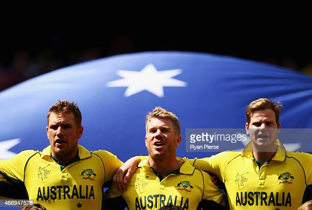 Aaron Finch David Warner and Steve Smith of Australia sing the national anthem during the 2015 ICC Cricket World Cup match between Australian and...