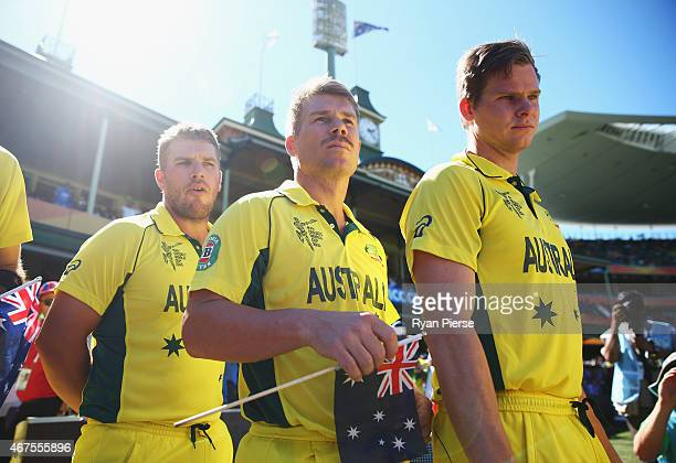 Aaron Finch David Warner and Steve Smith of Australia walk out for the national anthems during the 2015 Cricket World Cup Semi Final match between...