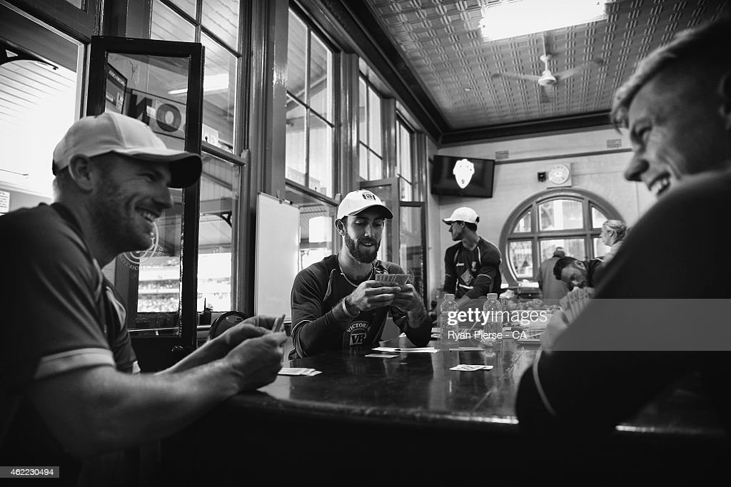Aaron Finch, Glenn Maxwell and and Xavier Doherty of Australia play cards in the change rooms during a rain delay during the One Day International match between Australia and India at Sydney Cricket Ground on January 26, 2015 in Sydney, Australia.