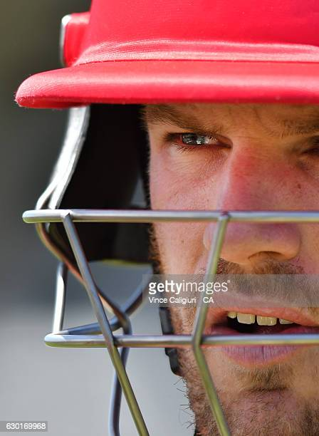Aaron Finch is seen heading out to bat in the official practice game during the Melbourne Renegades Family Day at Merv Hughes Oval on December 18...