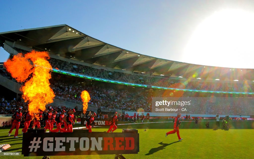 Aaron Finch leads the Renegades through flames onto the field during the Big Bash League match between the Melbourne Renegades and the Sydney Sixers on January 3, 2018 in Geelong, Australia.