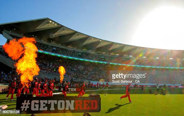Aaron Finch leads the Renegades through flames onto the field during the Big Bash League match between the Melbourne Renegades and the Sydney Sixers...
