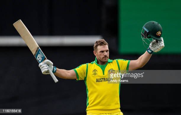 Aaron Finch of Australia acknowledges the applause on reaching his century during the Group Stage match of the ICC Cricket World Cup 2019 between Sri...