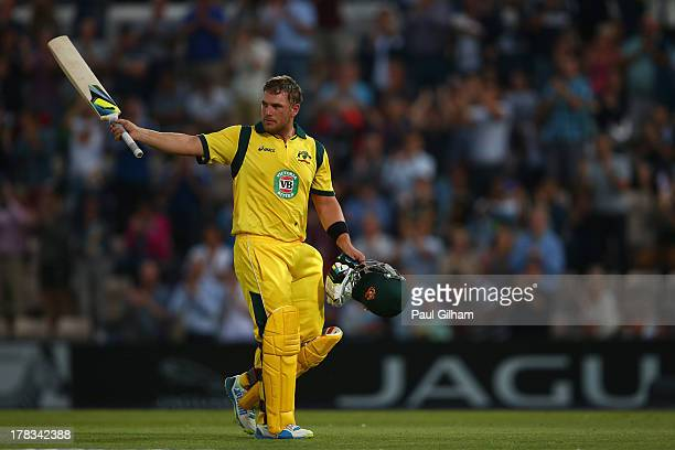 Aaron Finch of Australia acknowledges the crowd as he walks off after hitting a record 156 runs during the 1st NatWest Series T20 match between...
