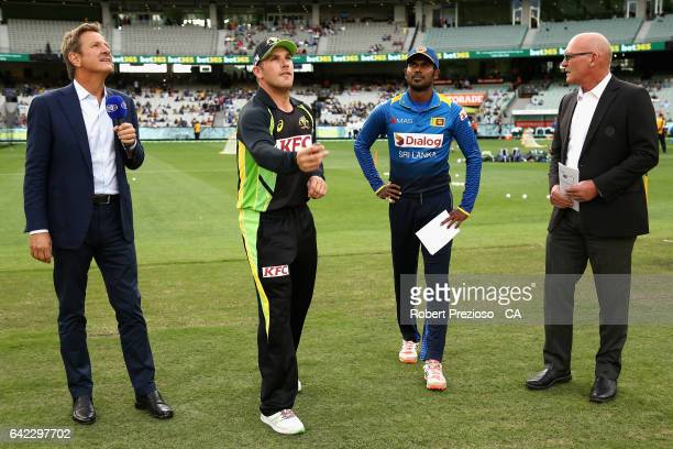 Aaron Finch of Australia and Upul Tharanga of Sri Lanka complete the coin toss during the first International Twenty20 match between Australia and...