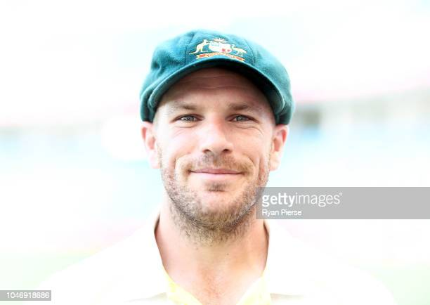 Aaron Finch of Australia Australia poses after receiving their Baggy Green Caps during day one of the First Test match in the series between...