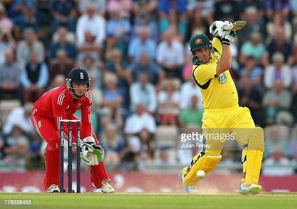 Aaron Finch of Australia bats as Jos Buttler of England keeps wicket during the 1st NatWest Series T20 match between England and Australia at Ageas...