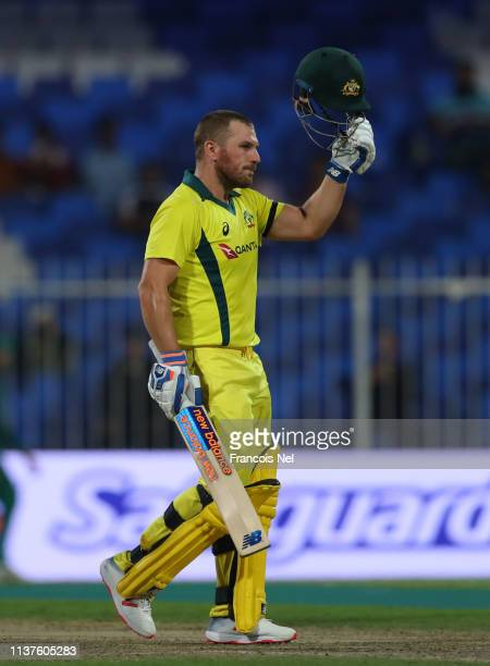 Aaron Finch of Australia celebrates after reaching his century during the first One Day International match between Pakistan and Australia at Sharjah...