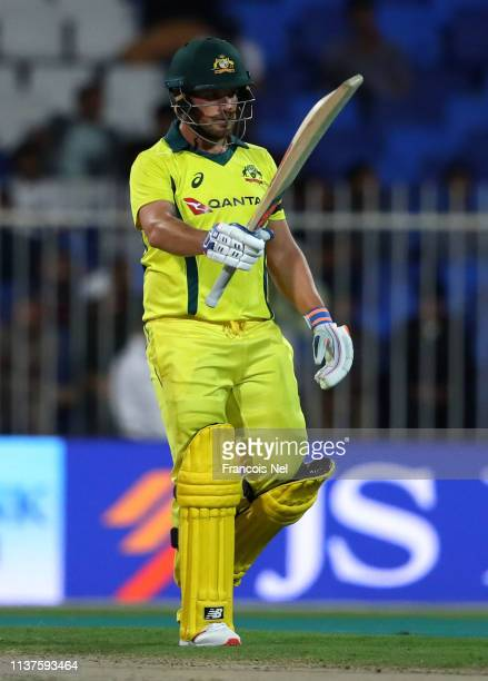 Aaron Finch of Australia celebrates after reaching his half century during the first One Day International match between Pakistan and Australia at...