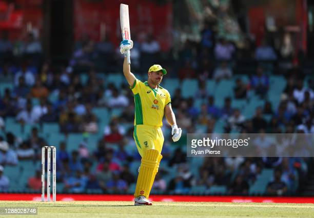 Aaron Finch of Australia celebrates after reaching his half century during game one of the One Day International series between Australia and India...