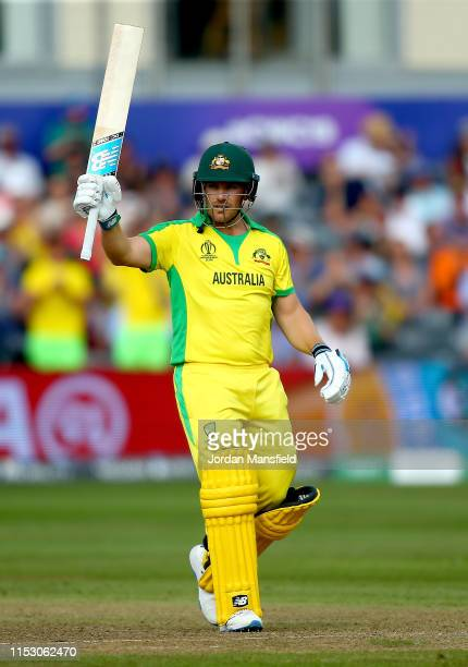 Aaron Finch of Australia celebrates his 50 during the Group Stage match of the ICC Cricket World Cup 2019 between Afghanistan and Australia at...