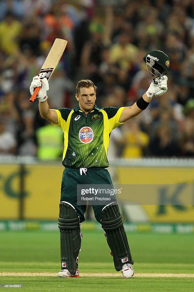 Aaron Finch of Australia celebrates his century during game one of the one day international series between Australia and England at Melbourne Cricket Ground on January 12, 2014 in Melbourne, Australia.