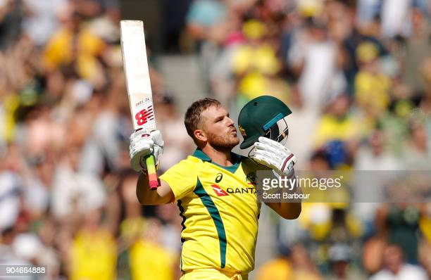 Aaron Finch of Australia celebrates his century during game one of the One Day International Series between Australia and England at Melbourne...