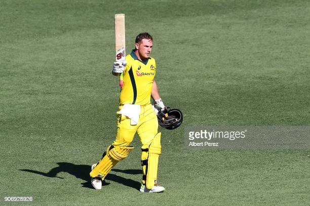 Aaron Finch of Australia celebrates his century during game two of the One Day International Series between Australia and England at The Gabba on...
