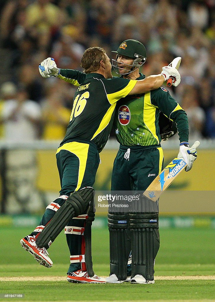 Aaron Finch of Australia celebrates his century with Michael Clarke of Australia during game one of the one day international series between Australia and England at Melbourne Cricket Ground on January 12, 2014 in Melbourne, Australia.