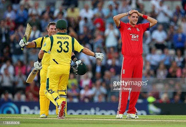 Aaron Finch of Australia celebrates his century with Shane Watson of Australia as Stuart Broad of England looks on during the 1st NatWest Series T20...