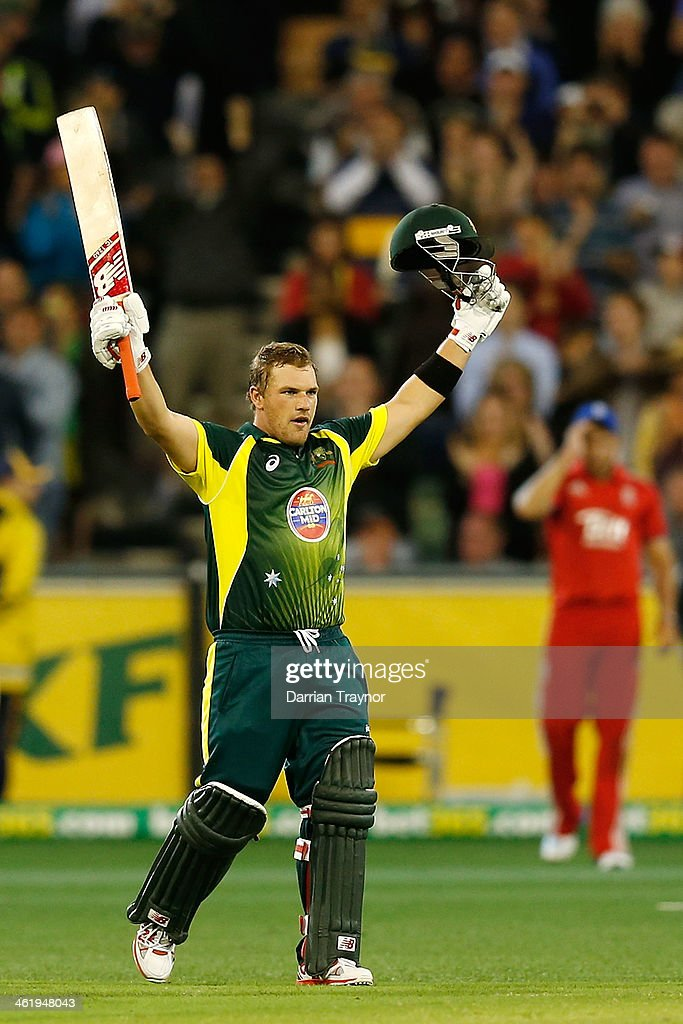 Aaron Finch of Australia celebrates making 100 runs during game one of the one day international series between Australia and England at Melbourne Cricket Ground on January 12, 2014 in Melbourne, Australia.