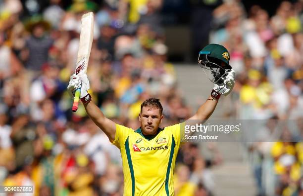 Aaron Finch of Australia celebrates reaching his century during game one of the One Day International Series between Australia and England at...