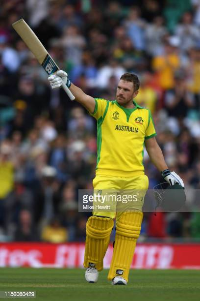 Aaron Finch of Australia celebrates reaching his century during the Group Stage match of the ICC Cricket World Cup 2019 between Sri Lanka and...