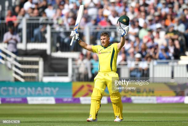 Aaron Finch of Australia celebrates reaching his century during the 4th Royal London One Day International between England and Australia at Emirates...