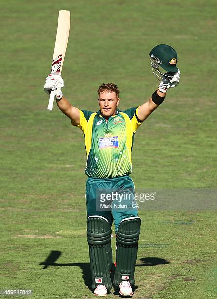 Aaron Finch of Australia celebrates scoring a century during game three of the One Day International Series between Australia and South Africa at...