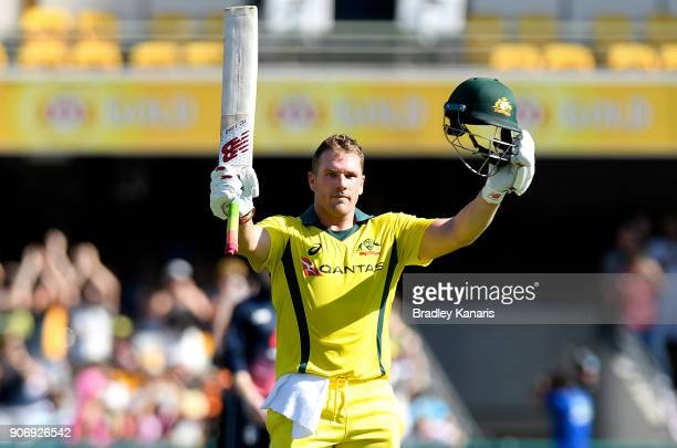 Aaron Finch of Australia celebrates scoring a century during game two of the One Day International series between Australia and England at The Gabba...