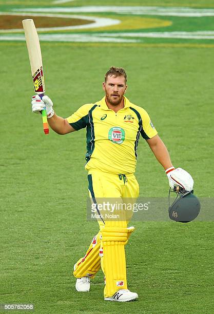 Aaron Finch of Australia celebrates scoring a century during the Victoria Bitter One Day International match between Australia and India at Manuka...