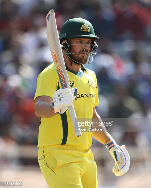 Aaron Finch of Australia celebrates scoring his fifty runs during game three of the One Day International series between India and Australia at JSCA...