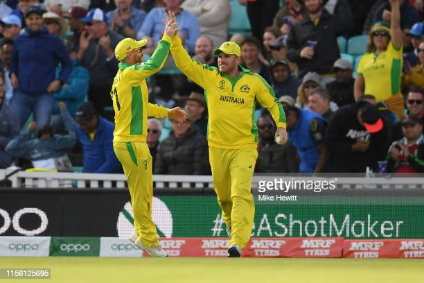 Aaron Finch of Australia celebrates with David Warner after catching Isuru Udana of Sri Lanka during the Group Stage match of the ICC Cricket World...