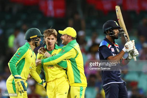 Aaron Finch of Australia congratulates Adam Zampa of Australia after dismissing KL Rahul of India during game two of the One Day International series...