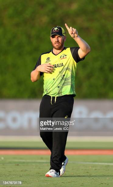 Aaron Finch of Australia gives instructions to their side during the India and Australia warm Up Match prior to the ICC Men's T20 World Cup at on...