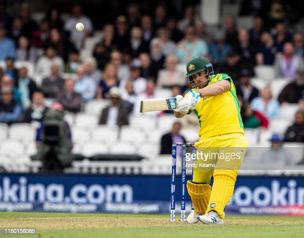 Aaron Finch of Australia hits the ball high into the sky to end his innings of 153 runs during the Group Stage match of the ICC Cricket World Cup...