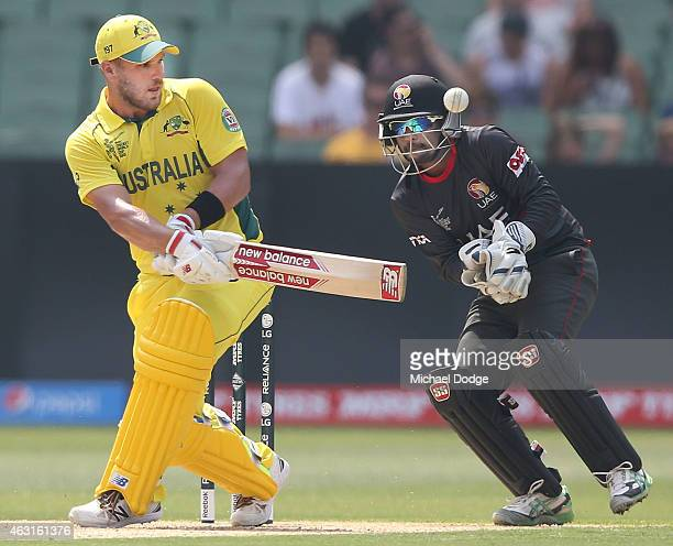Aaron Finch of Australia hits the ball past wicket keeper Swapnil Patil of UAE during the Cricket World Cup warm up match between Australia and the...