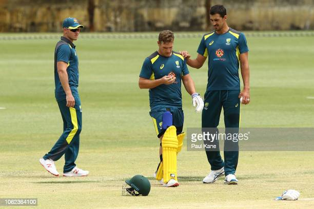 Aaron Finch of Australia inspects his finger after being struck by a delivery off Mitchell Starc during the Australia ODI nets session at the WACA on...