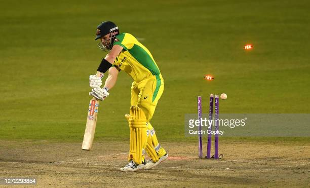 Aaron Finch of Australia is bowled by Chris Woakes of England during the 2nd Royal London One Day International Series match between England and...