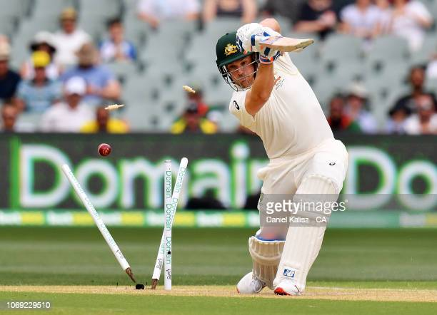 Aaron Finch of Australia is bowled by Ishant Sharma of India during day two of the First Test match in the series between Australia and India at...