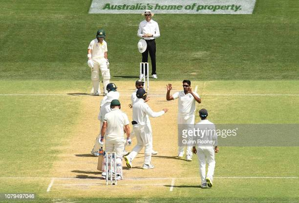 Aaron Finch of Australia is caught by Rishabh Pant of India during day four of the First Test match in the series between Australia and India at...