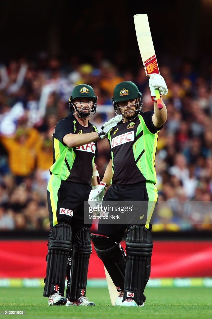 Aaron Finch of Australia is congratulated by teammate Michael Klinger after Finch made 50 runs during the International Twenty20 match between Australia and Sri Lanka at Adelaide Oval on February 22, 2017 in Adelaide, Australia.