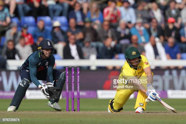 Aaron Finch of Australia is out LBW as Jos Buttler of England looks on during the 2nd Royal London One day International match between England and...